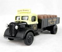 "Pocketbond ""Classix"" EM76309 Austin K2 dropside with barrel load in ""County Brewery"" livery"
